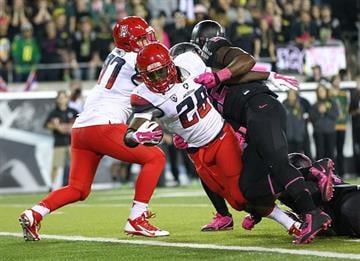 EUGENE, OR - OCTOBER 02: Nick Wilson #28 of the Arizona Wildcats scores a touchdown against of the Oregon Ducks at Autzen Stadium on October 2, 2014  in Eugene, Oregon.  (Photo by Jonathan Ferrey/Getty Images) By Jonathan Ferrey