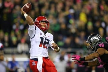 EUGENE, OR - OCTOBER 02: Anu Solomon #12 of the Arizona Wildcats throws a pass against Rodney Hardick #48 of the Oregon Ducks at Autzen Stadium on October 2, 2014  in Eugene, Oregon.  (Photo by Jonathan Ferrey/Getty Images) By Jonathan Ferrey