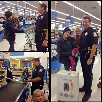 Emmett Township Public Safety Officer Ben Hall  purchases a car seat for a young mom and her child on Saturday, October 4, 2014. By Emmett Township Public Safety
