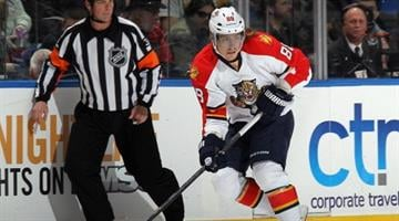 UNIONDALE, NY - MARCH 24: Peter Mueller #88 of the Florida Panthers skates against the New York Islanders at the Nassau Veterans Memorial Coliseum on March 24, 2013 in Uniondale, New York.  (Photo by Bruce Bennett/Getty Images) By Bruce Bennett