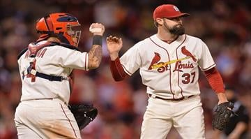 ST. LOUIS, MO - SEPTEMBER 13: Pat Neshek #37 and Yadier Molina #4 both of the St. Louis Cardinals celebrate after defeating 5-4 at Busch Stadium on September 13, 2014 in St. Louis, Missouri.  (Photo by Michael B. Thomas/Getty Images) By Michael B. Thomas