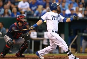 KANSAS CITY, MO - AUGUST 31:  Alex Gordon #4 of the Kansas City Royals hits a sacrifice fly in the first inning against the Cleveland Indians at Kauffman Stadium on August 31, 2014 in Kansas City, Missouri. (Photo by Ed Zurga/Getty Images) By Ed Zurga