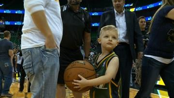JP Gibson, who was diagnosed with acute lymphoblastic leukemia in 2012, signed the contract with Jazz President Randy Rigby at 5:30 p.m. then joined the team in uniform on the bench. By KSTU