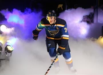 St. Louis Blues T.J. Oshie skates onto the ice as he is introduced on opening night before a game against the New York Rangers at the Scottrade Center in St. Louis on October 9, 2014. UPI/Bill Greenblatt By BILL GREENBLATT