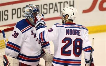 New York Rangers Dominic Moore congratulates goaltender Henrik Lundqvist at the final horn and a 3-2 win over the St. Louis Blues at the Scottrade Center in St. Louis on October 9, 2014. UPI/Bill Greenblatt By BILL GREENBLATT