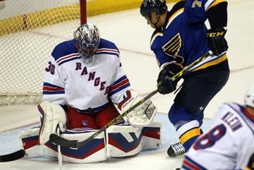 St. Louis Blues Ryan Reaves puts the puck in the lap of New York Rangers Henrik Lundqvist in the first period at the Scottrade Center in St. Louis on October 9, 2014. New York won the game 3-2. UPI/Bill Greenblatt By BILL GREENBLATT