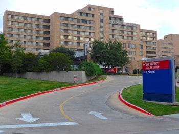 An exterior photograph of Texas Healthcare Presbyterian Hospital in Dallas, Texas, where Thomas Eric Duncan, the first person diagnosed with Ebola in the United States, died. Duncan passed on October 8, 2014. By William Walker