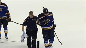 Paul Stastny is led from the ice following a collision in the season opener against the New York Rangers on October 9, 2014.  (Bryce Moore/HockeyStL) By Picasa