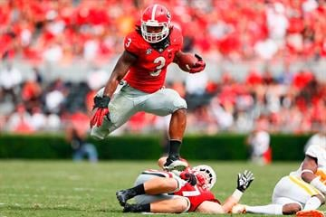 ATHENS, GA - SEPTEMBER 27:  Todd Gurley #3 of the Georgia Bulldogs leaps over Taylor Maxey #47 as he rushes against the Tennessee Volunteers at Sanford Stadium on September 27, 2014 in Athens, Georgia.  (Photo by Kevin C. Cox/Getty Images) By Kevin C. Cox