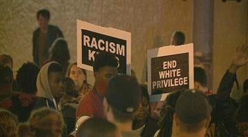 Nearly a thousand protesters descended on the campus of St. Louis University Sunday night. By Stephanie Baumer