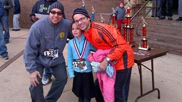 [4/5] Mayor Alex Blanco, Sommer's daughter Maayan and Sommer pose for a photo after a race in Passaic, New Jersey, in October 2013. By Courtesy Pesach Sommer