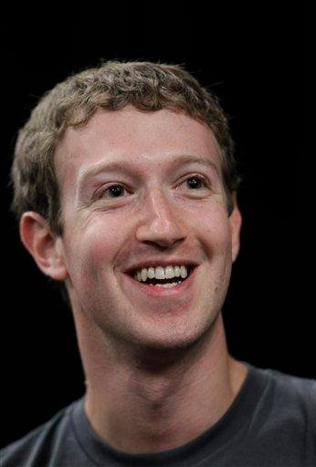 Facebook CEO Mark Zuckerberg smiles at a news conference during the f/8 conference in San Francisco, Thursday, Sept. 22, 2011.  The conference boasts some 2,000 entrepreneurs, developers and journalists. (AP Photo/Paul Sakuma) By Paul Sakuma