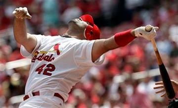 St. Louis Cardinals' Albert Pujols watches a foul ball while batting during the first inning of a baseball game against the Houston Astros Thursday, April 15, 2010, in St. Louis. (AP Photo/Jeff Roberson) By Jeff Roberson