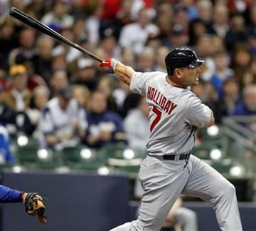 St. Louis Cardinals' Matt Holliday watches his two-run home run against the Milwaukee Brewers in the sixth inning of a baseball game Friday, April 9, 2010, in Milwaukee. (AP Photo/Jeffrey Phelps) By Jeffrey Phelps