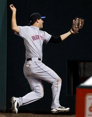 New York Mets right fielder Jeff Francoeur catches a fly ball his by St. Louis Cardinals catcher Yadier Molina during the fourth inning of a baseball game Friday, April 16, 2010, in St. Louis. (AP Photo/Jeff Roberson) By Jeff Roberson