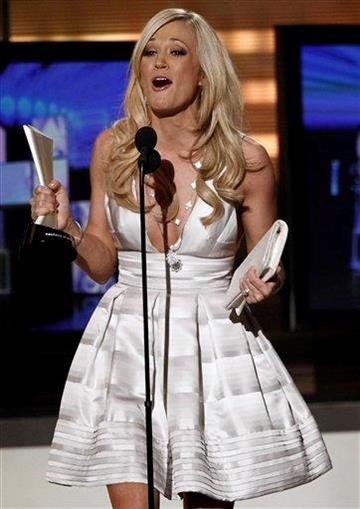 Carrie Underwood accepts the award for Entertainer of the Year at the 45th Annual Academy of Country Music Awards in Las Vegas on Sunday, April 18, 2010.  (AP Photo/Matt Sayles) By Matt Sayles