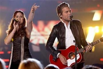 Rachel Reinert, left, and Tom Gossin, of Gloriana, perform at the 45th Annual Academy of Country Music Awards in Las Vegas on Sunday, April 18, 2010.  (AP Photo/Matt Sayles) By Matt Sayles