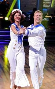 "In this publicity image released by ABC, Nicole Scherzinger, left,, and her partner Derek Hough perform on ""Dancing with the Stars,"" Monday, April 5, 2010 in Los Angeles. (AP Photo/ABC, Adam Larkey) By Adam Larkey"