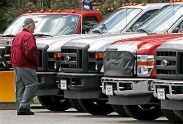 Walter Arbuckle of Braintree, Vt. looks over Ford F-150s at the Formula Ford dealership in Montpelier, Vt., Wednesday, April 21, 2010. (AP Photo/Toby Talbot) By Toby Talbot