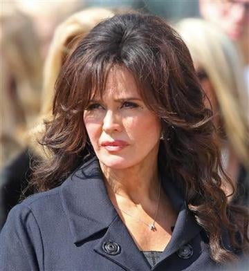 Marie Osmond watches as the casket of her son Michael Bryan, 18, is taken from a church after his funeral in Provo, Utah on Monday, March 8, 2010. (AP Photo/George Frey) By George Frey