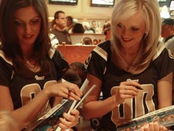 Rams cheerleaders signing autographs at the team's official draft watch party. By KMOV Web Producer