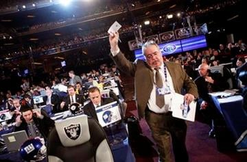 A team's pick is taken to the stage during the second round of the NFL football draft at Radio City Music Hall Friday, April 23, 2010 in New York. (AP Photo/Jason DeCrow) By Jason DeCrow