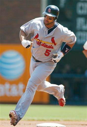 St. Louis Cardinals' Albert Pujols rounds second base after hitting a home run against the San Francisco Giants during the first inning of a baseball game, Sunday, April 25, 2010, in San Francisco. (AP Photo/George Nikitin) By George Nikitin