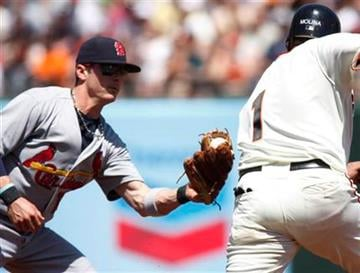 St. Louis Cardinals' Brendan Ryan, left, tags out San Francisco Giants' Bengie Molina in a double play during the second inning of a baseball game, Sunday, April 25, 2010, in San Francisco. (AP Photo/George Nikitin) By George Nikitin