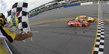 Kevin Harvick (29) edges out Jamie McMurray at the finish line to win the NASCAR Sprint Cup Series Aaron's 499 auto race at Talladega Superspeedway in Talladega, Ala., Sunday, April 25, 2010. (AP Photo/Todd Warshaw,Pool) By Todd Warshaw