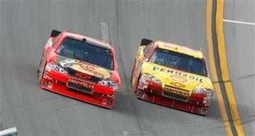 Kevin Harvick, right, drops low to pass  Jamie McMurray on the last lap to win the NASCAR Sprint Cup Series Aaron's 499 auto race at Talladega Superspeedway in Talladega, Ala., Sunday, April 25, 2010. (AP Photo/Glenn Smith) By Glenn Smith