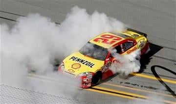 Kevin Harvick celebrates winning the NASCAR Sprint Cup Series Aaron's 499 auto race at Talladega Superspeedway in Talladega, Ala., Sunday, April 25, 2010. (AP Photo/Glenn Smith) By Glenn Smith