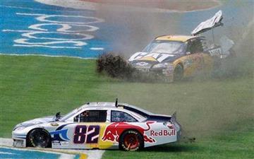 Scott Speed (82) and Jeff Burton slide through the grass during the NASCAR Sprint Cup Series Aaron's 499 auto race at Talladega Superspeedway in Talladega, Ala., Sunday, April 25, 2010. (AP Photo/Glenn Smith) By Glenn Smith