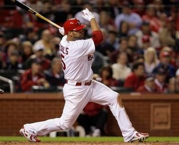St. Louis Cardinals first baseman Albert Pujols connects for a single in the fourth inning of a baseball game against the Atlanta Braves, Monday, April 26, 2010 in St. Louis.(AP Photo/Tom Gannam) By Tom Gannam