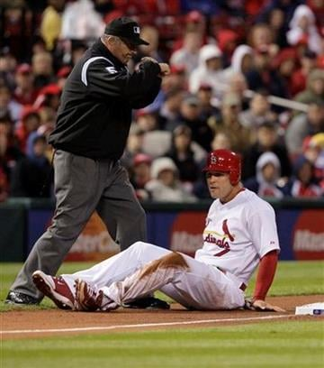 Third base umpire Dale Scott calls  out St. Louis Cardinals' Matt Holliday (7) after he was caught stealing third in the second inning of a baseball game against the Atlanta Braves, Monday, April 26, 2010 in St. Louis.(AP Photo/Tom Gannam) By Tom Gannam