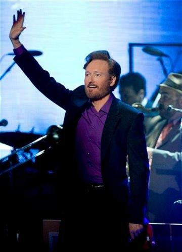 """Comedian Conan O'Brien performs during a stop of """"The Legally Prohibited From Being Funny on Television Tour"""" in Vancouver, British Columbia, Tuesday, April 13, 2010. (AP Photo/THE CANADIAN PRESS/Jonathan Hayward) By Jonathan Hayward"""