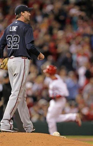 Atlanta Braves starting pitcher Derek Lowe regroups as St. Louis Cardinals' Ryan Ludwick circles the bases after hitting a solo home run in the fourth inning of a baseball game Tuesday, April 27, 2010, in St. Louis.(AP Photo/Tom Gannam) By Tom Gannam