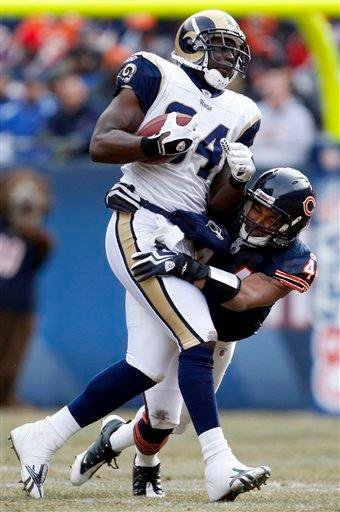 St. Louis Rams tight end Randy McMichael (84) is stopped by Chicago Bears safety Kevin Payne (44) during the first half of an NFL football game in Chicago, Sunday, Dec. 6, 2009. (AP Photo/Nam Y. Huh) By Nam Y. Huh
