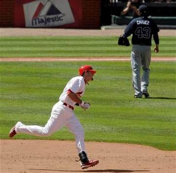 St. Louis Cardinals' Tyler Greene rounds the bases on a solo home run off Atlanta Braves relief pitcher Jesse Chavez, rear, during the seventh inning of a baseball game Thursday, April 29, 2010, in St. Louis. (AP Photo/Jeff Roberson) By Jeff Roberson