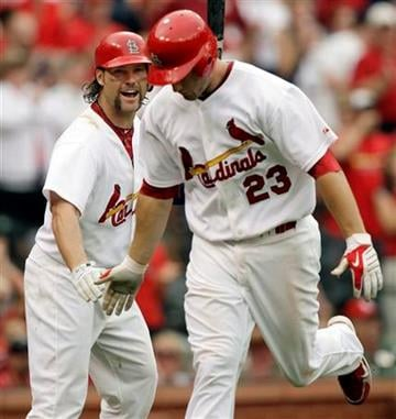 St. Louis Cardinals' Jason LaRue, left, congratulates teammate David Freese on his solo home run during the fourth inning of a baseball game against the Cincinnati Reds, Saturday, May 1, 2010, in St. Louis. (AP Photo/Jeff Roberson) By Jeff Roberson