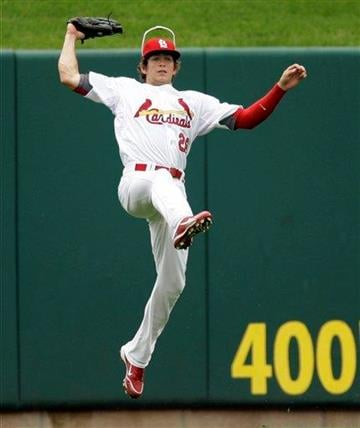 St. Louis Cardinals center fielder Colby Rasmus leaps into the air to catch a ball hit by Cincinnati Reds' Drew Stubbs for the out during the third inning of a baseball game Saturday, May 1, 2010, in St. Louis. (AP Photo/Jeff Roberson) By Jeff Roberson