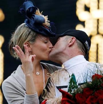 Calvin Borel kisses his wife, Lisa, after Borel rode Super Saver to victory in the 136th Kentucky Derby horse race at Churchill Downs Saturday, May 1, 2010, in Louisville, Ky. (AP Photo/Matt Slocum) By Matt Slocum