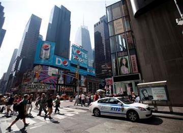 A police car is parked right near the spot where a crude car bomb was discovered the night before in Times Square in New York, Sunday, May 2, 2010.  (AP Photo/Seth Wenig) By Seth Wenig
