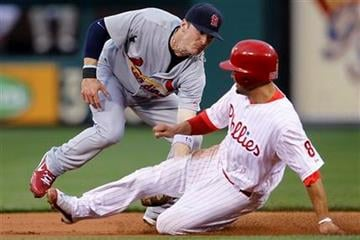 Philadelphia Phillies' Shane Victorino, right, is caught trying to steal second base by St. Louis Cardinals' Brendan Ryan in the first inning of a baseball game, Monday, May 3, 2010, in Philadelphia. (AP Photo/Matt Slocum) By Matt Slocum