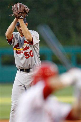 St. Louis Cardinals' Adam Wainwright, left, winds up to pitch against Philadelphia Phillies' Placido Polanco in the first inning of a baseball game, Tuesday, May 4, 2010, in Philadelphia. (AP Photo/Matt Slocum) By Matt Slocum