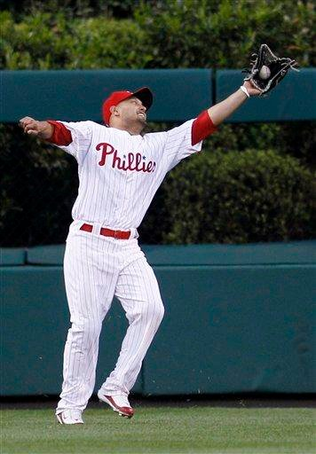 Philadelphia Phillies' Shane Victorino grabs a deep fly out by St. Louis Cardinals' Adam Wainwright in the third inning of a baseball game, Tuesday, May 4, 2010, in Philadelphia. (AP Photo/Matt Slocum) By Matt Slocum