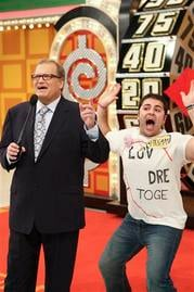 """In this publicity image released by CBS, host Drew Carey, left,stands with contestant Payman Farrokhgar on stage during """"The Price is Right,"""" in Los Angeles. (AP Photo/CBS, Monty Brinton) By MONTY BRINTON"""