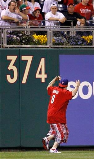A fan runs onto the field in the ninth  inning of a baseball game between the Philadelphia Phillies and the St. Louis Cardinals, Tuesday, May 4, 2010, in Philadelphia. (AP Photo/Matt Slocum) By Matt Slocum