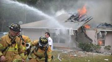 A scene of a plane crash in Palm Coast, Florida, Jan. 4, 2013. / CBS/WKMG/Flagler Live By Dan Mueller