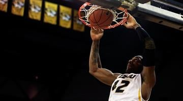 COLUMBIA, MO - JANUARY 08:  Alex Oriakhi #42 of the Missouri Tigers dunks during the game against the Alabama Crimson Tide at Mizzou Arena on January 8, 2013 in Columbia, Missouri.  (Photo by Jamie Squire/Getty Images) By Eric Lorenz