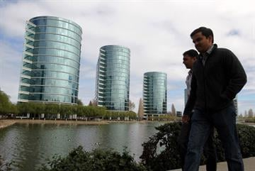 REDWOOD SHORES, CA - MARCH 20:  Pedestrians walks by Oracle headquarters on March 20, 2012 in Redwood Shores, California.  Oracle will report third quarter earnings today after the closing bell. (Photo by Justin Sullivan/Getty Images) By Justin Sullivan